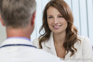 Plastic Surgeon Talking To Patient